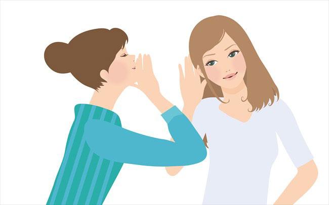 噂話をする女性二人